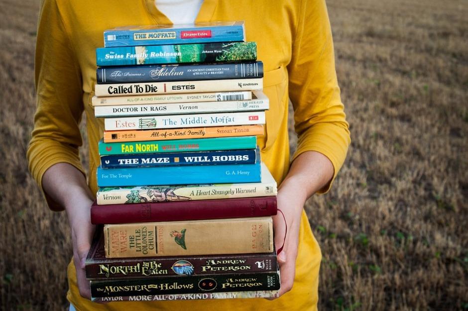 girl-carrying-books-pixabay